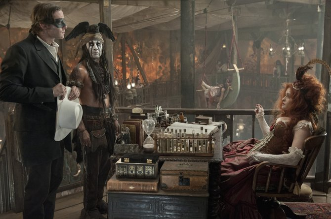 "John Reid and Tonto (Armie Hammer, Johnny Depp) question brothel owner Red (Helena Bonham Carter) in ""The Lone Ranger."" The movie is a remake of the classic tale about a masked lawman in the 1860s."