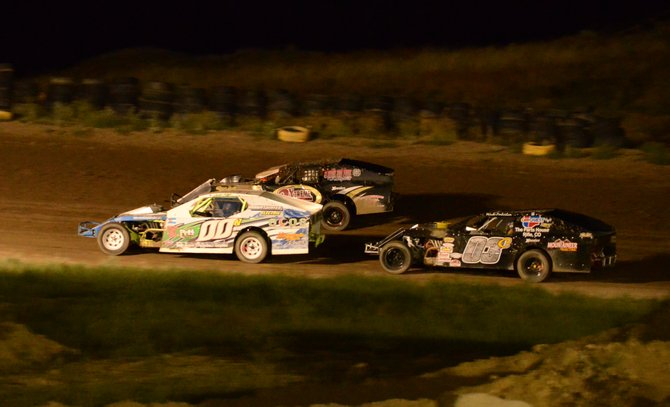 Josh Nye (00), Wade Pinkerton (03) and Mike Opatik race closely during the modified stock car race Friday night at Thunder Ridge Motorsports Park.