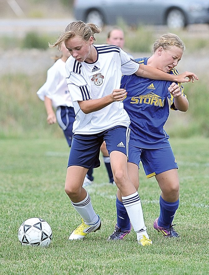 Steamboat Springs soccer player Delaney Moon looks for a little separation while attempting to control the ball in a U11 girls soccer game in 2012 at Heritage Park. The Steamboat Mountain Soccer Tournament will see play begin Thursday and games will run throughout the weekend with 126 soccer teams participating.