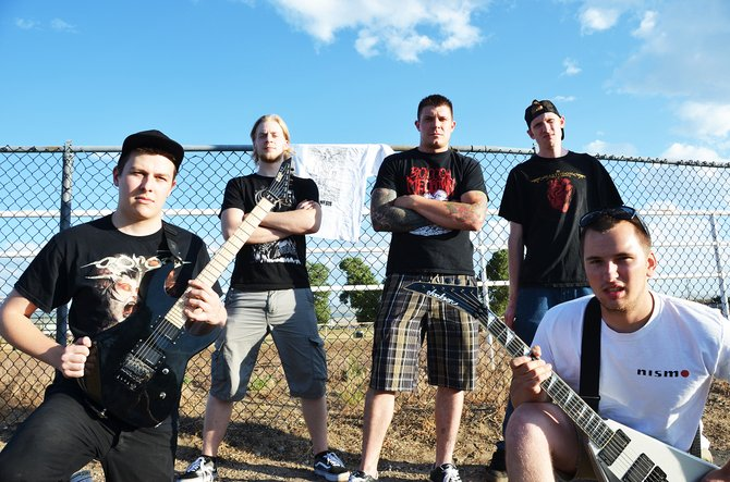 Denver band Artemesis prepares for their set Saturday night at the Moffat County Fairgrounds Pavilion. The concert included performances by four metal bands from around the state.