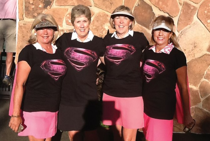 These women from Douglas County were pretty in pink for Tuesday's Rally for the Cure golf tournament. The golfers — Jane Videtich, from left, Barb Dearing, Ginna Riggall and Kathleen Albert — made the Rally for a Cure golf tournament part of their week.