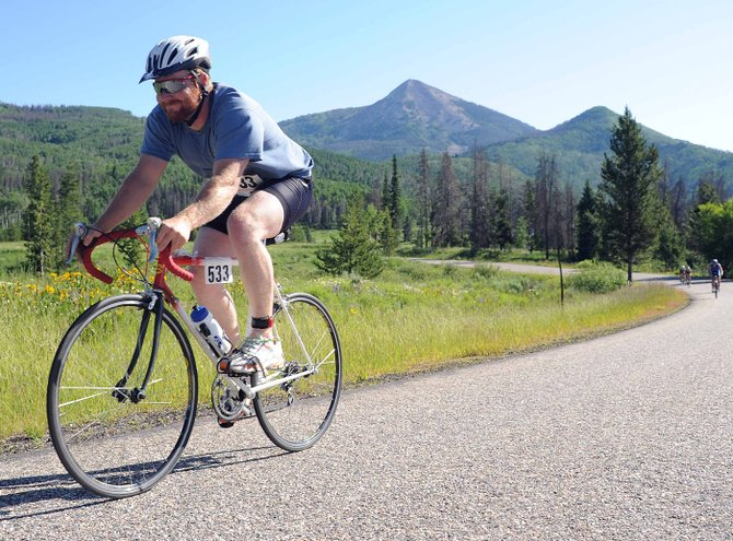 Zach Sanders rides in the Steamboat Lake Sprint Triathlon in July 2011. This year's event gets started at 8 a.m. Sunday in North Routt.