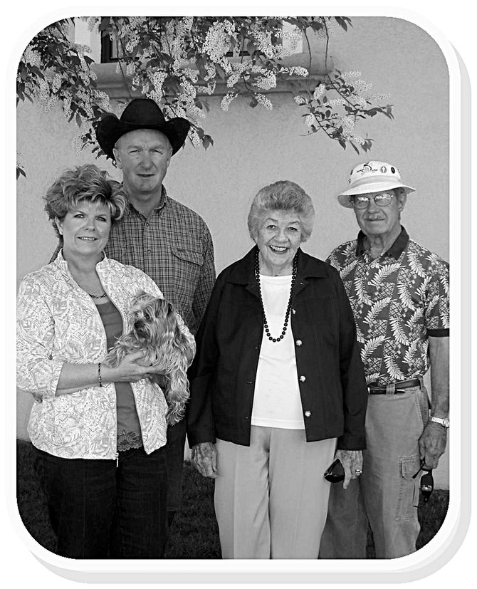 Elaine and Melton Sullivan, stand next to Elaine's parents Jill and Neil McCandless. Elaine holds their dog Zoey. The Moffat County Fair Board dedicates this years fair to Elaine Sullivan.