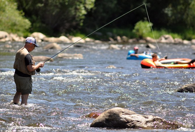 Anglers and tubers enjoy the Yampa River in the summer near Steamboat Springs.