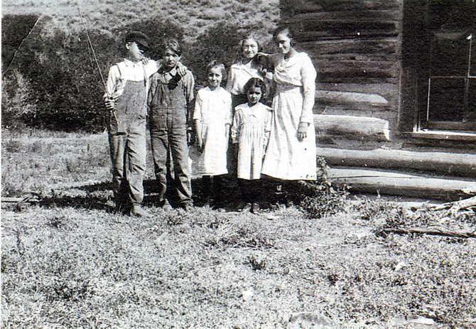 Irene Hurd, back and 2nd from right, stands with her classmates at their school on Little Bear.
