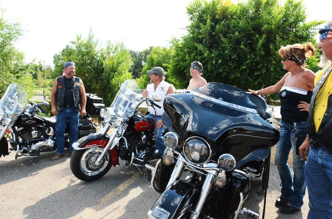 From left, John Kromer, Greg Brewer, Jayne McCormick, Julie Hall and LeeLand Mischke get back from participating in OP Bar & Grill's 17th annual Poker Run.