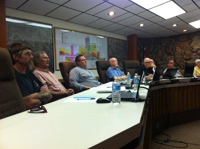 From left, City Council Members, Jarrod Ogden, Don Jones, Tony Bohrer, Mayor Terry Carwile, Ray Beck, Gene Bilodeau and Joe Bird listen to community concerns about an ordinance that would prohibit recreational marijuana establishments in Craig.