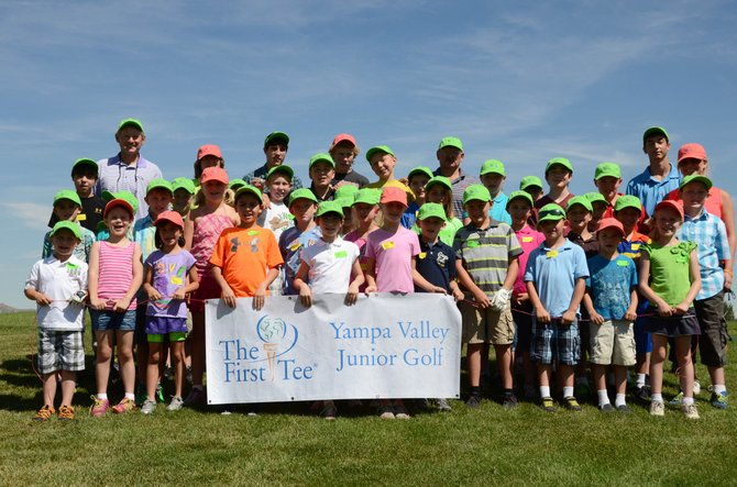 Children and coaches in the Yampa Valley Junior Golf program stand near the driving range at Yampa Valley Golf Course on Tuesday. Yampa Valley Junior Golf has attracted more 50 golfers from ages 6 to 15 throughout the summer, teaching them values for life and about the game of golf.
