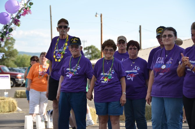Craig residents get ready for the survivors lap of the 2013 Relay For Life Friday night. This year's event brought in about $8,500 in cash, combined with donated goods that brought the total to about $10,000.