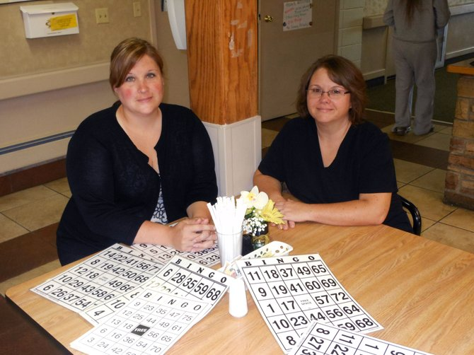 Dollie Rose and Wenona Harper sit at one of the activity tables of Sandrock Ridge Care & Rehab. The two were recently brought on as the new nursing home administrator and director of nursing, respectively.