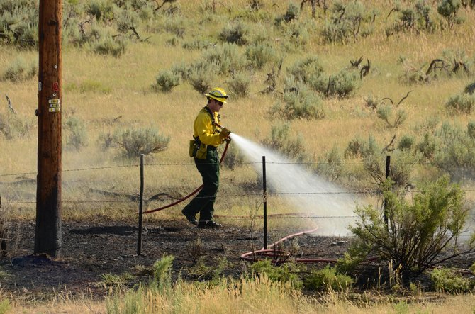Craig Fire and Rescue crews work on completing their suppression efforts of a small fire that ignited west of Craig Friday afternoon. The flames begin on and around an electric pole along Highway 40 about one mile west of Craig, but were quickly suppressed.