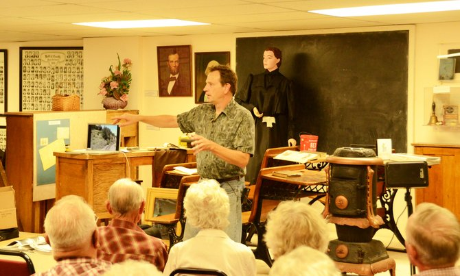 Rand Hood speaks to Craig community members Saturday about the Moffat Railroad in the basement of the Museum of Northwest Colorado.