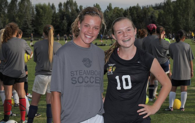 Natalie Bohlmann, left, and Emily Cope are two rising sophomores at their respective schools and were born into the Battle Mountain-Steamboat Springs soccer rivalry.