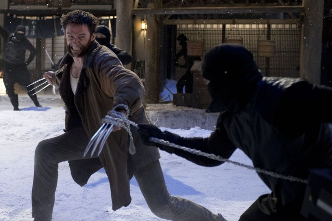"Logan (Hugh Jackman) faces off against a squadron of ninjas in ""The Wolverine."" The movie is about the continuing adventures of the mutant superhero and occasional member of the X-Men as he fights foes in Japan."