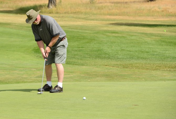 Steve Harrell watches his putt track for the hole on the ninth green Thursday at Yampa Valley Golf Course. Harrell and teammates Alan Hathhorn, Trent Durham and Dave Rigsby shot a 73 as part of the Twenty Mile scramble tournaments Wednesday and Thursday, which raised money for the American Diabetes Association.
