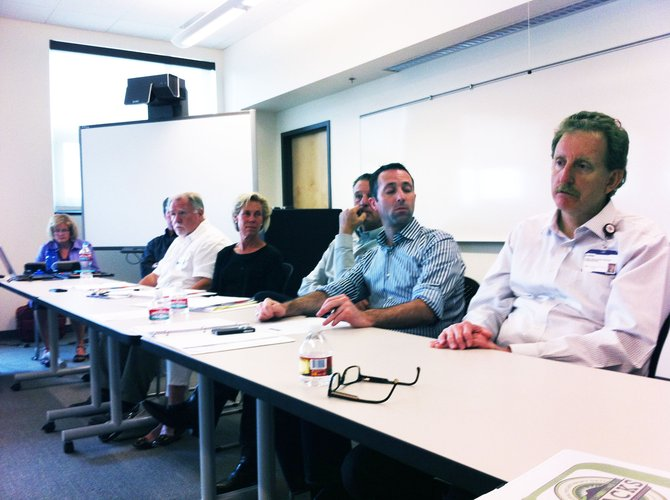 From left, Kate Nowack, Joe Carter, Michael Melneck, Suzanne White, Tim Schultz, Abel Wurmnest and Chris Smolik discuss the different programs and organizations that need funding in Moffat County.