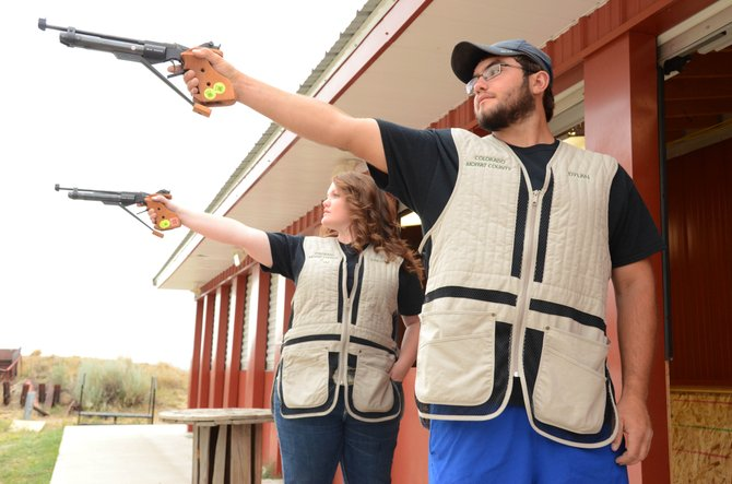 Dylan Villa (front) and Dakota Lee take aim with their air pistols at the Bears Ears sportsman range. They both represented the state of Colorado in the 4-H 2013 National Shooting Sports Invitational at the end of June, and will look to qualify again at the Colorado shoot Aug. 17.