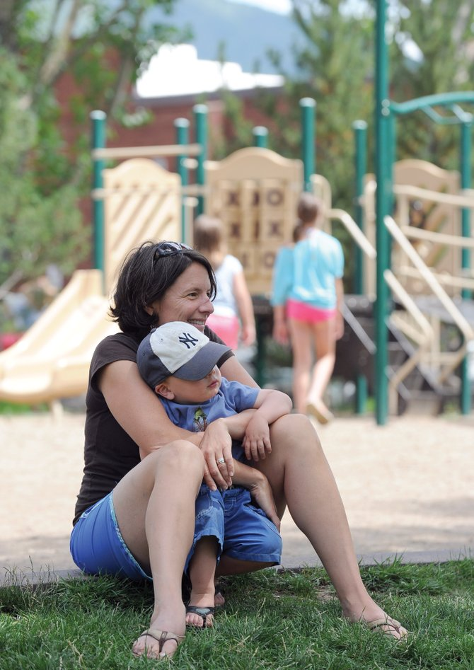 Liz Baldwin hangs out with her son Everett at Little Toots Park on Friday afternoon. Steamboat Springs ranked No. 11 on a list of Colorado cities for young families.