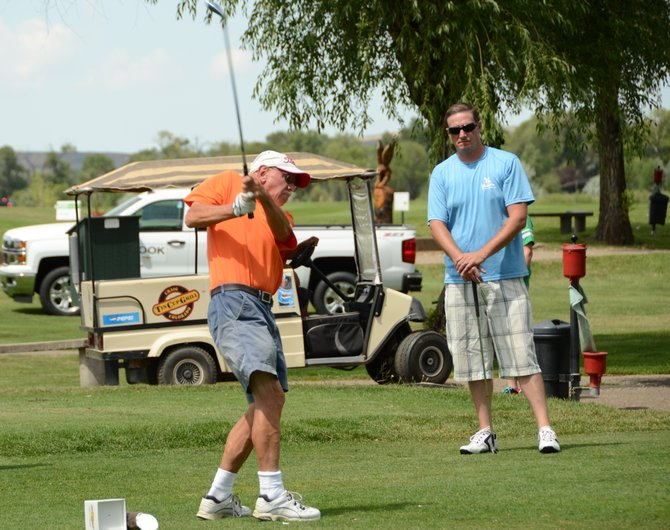 Wolfgang Glaeser hits from the tee box on the seventh hole at Yampa Valley Golf Course. Glaeser and teammates Dave Dimick, Matt Winey and Chris Dotson took part in the Bear River Young Life Golf Tournament in Craig on Saturday.