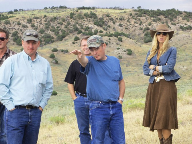 Rancher Rex Tuttle points out the geographical features of Cedar Springs Draw to a crowd during the Sage Grouse Initiative Tour on Tuesday afternoon. The event highlighted areas where the birds reside within Moffat County.