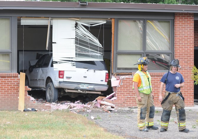 West Routt Fire Protection District firefighters Nick, left, and Wayne Deluca check out the scene where a Ford Expedition crashed into Hayden Middle School on Tuesday afternoon. Investigators are asking anyone who witnessed the incidents to contact Sgt. Scott Elliott with the Colorado State Patrol at 970-879-0059 or police officer Jarrod Poley with the Hayden Police Department at 970-276-3232.