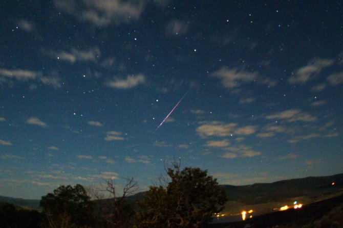 A colorful Perseid meteor streaks over Stagecoach State Park in this image taken in the predawn hours of Aug. 12, 2009. This year's display could produce more than 60 meteors per hour between midnight and dawn Monday and Tuesday mornings.