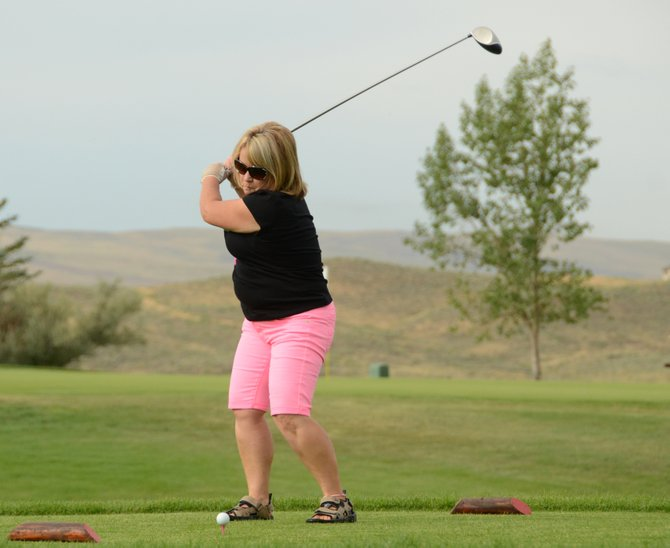Mary Ann Harrison tees off the 10th hole at Yampa Valley Golf Course on Wednesday morning. She and teammates Linda Showalter, Phyllis Virden and Helen Knez took part in the Rally for the Cause scramble tournament at the course, raising money for the Moffat County Cancer Society.