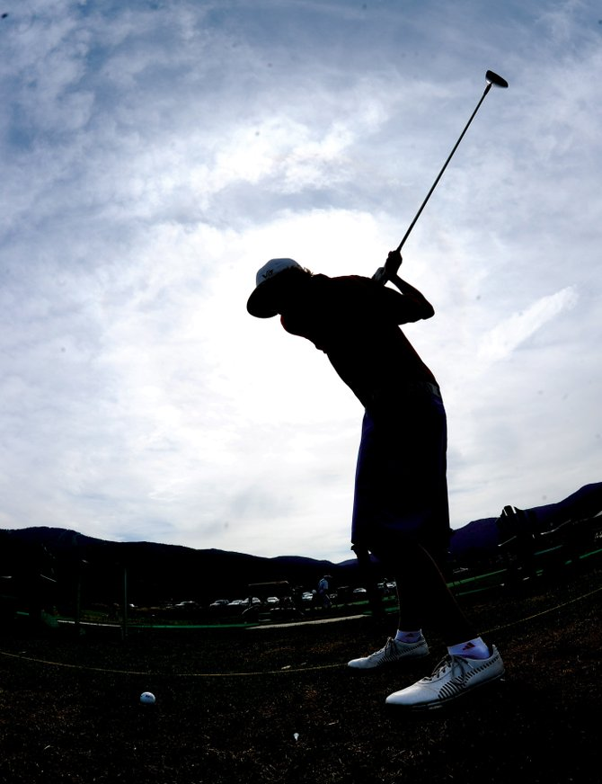 Steamboat Springs High School golfer Brandon Martin warms up on the driving range before heading out at Haymaker Golf Course on Wednesday. The high school team is slated to open the season at Battlement Mesa on Thursday.