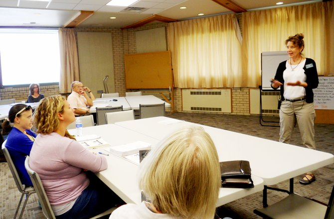Nancy Banman talks with leaders from Moffat, Routt and Rio Blanco counties about how to strengthen the region's economy.