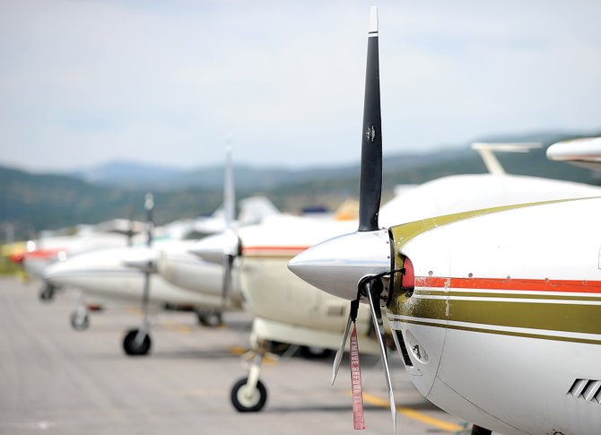 A row of planes line the apron at Steamboat Springs Airport, where the Yampa Valley Airport authority board met Thursday evening. Aircraft operations at the Steamboat airport were up 13.4 percent in July to 1,322 arrivals and departures. The airport staff estimates that 33 percent of operations were by turbine or jet aircraft.
