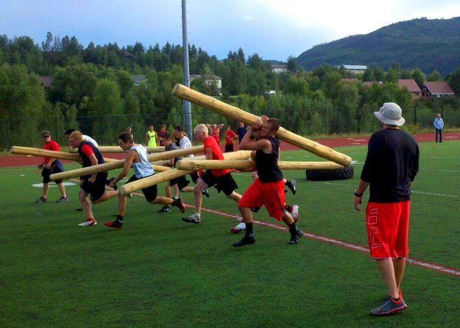 The Steamboat Springs High School football team prepare for the upcoming season using a CrossFit drill called build the fence.