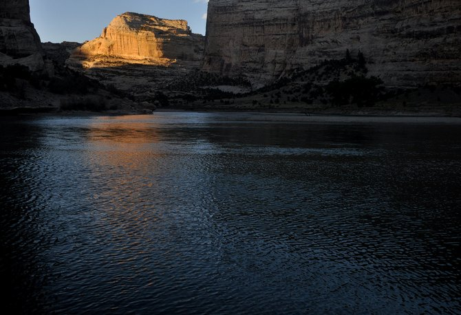 The sun sets in Dinosaur National Monument near the confluence of the Yampa and Green rivers. Campers can find solitude in Echo Park in the heart of the monument.