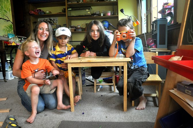 Chrissy Skorkowsky's home-based child care center in Oak Creek is unique. Above, she poses from left with Coen Dore, Steven Tzerovski, her daughter Sora and her son, Gannon.