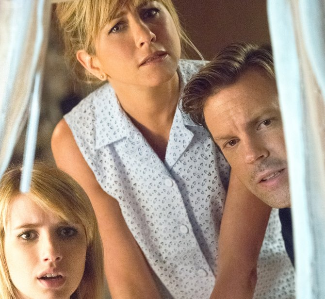 "Casey (Emma Roberts), Rose (Jennifer Aniston) and David (Jason Sudeikis) share an awkward moment in ""We're the Millers."" The movie is about a drug dealer who hires his neighbors to pose as his family while moving product across the U.S./Mexican border."