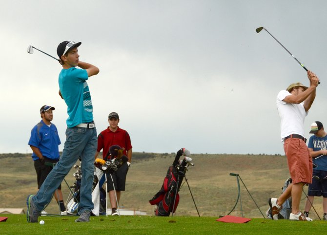Junior Casey Nations, left, and senior Taft Cleverly, right, hit off the driving range at Yampa Valley Golf Course. Nations and Cleverly are two of the top three golfers entering the season for the Moffat County High School boys golf team, which has set high expectations for itself in 2013.
