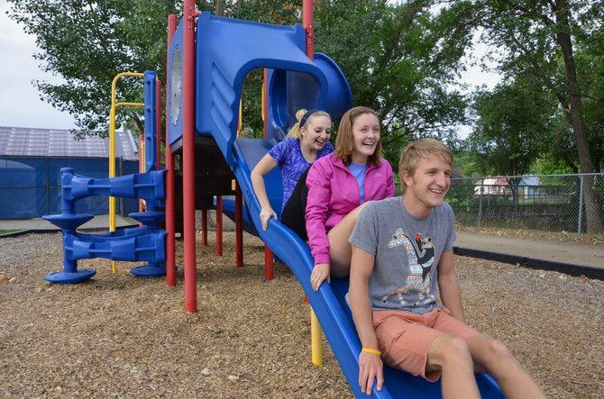 Moffat County High School students Tiffany Lingo and Aubrey Campbell follow Derek Maiolo's lead down the slide at Craig City Park. Lingo and Campbell recently attended a leadership conference in Estes Park through Rocky Mountain RYLA where Maiolo was one of the junior counselors.