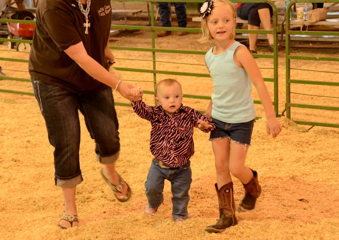 Aislyn Buckner, 15 months, competed in the Cowboy Baby contest Saturday at the 2013 Moffat County Fair. Buckner was one of 12 contestants two and younger to walk around the livestock barn in their best western outfits. Buckner was awarded as Future Big Game Hunter by the judges.