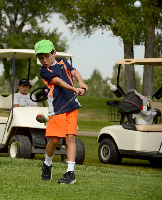 Kale Beckett tees off the first hole at Yampa Valley Golf Course Tuesday for the Yampa River Junior Classic. Beckett tied for the win among golfers who played five holes, shooting a 39 on the day.