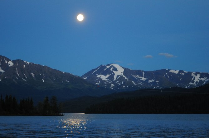 This year's Green Corn Moon, seen here shimmering on the surface of Alaska's Kenai Lake, fell on July 22. That timing allows for two more full moons this summer, making the one Aug. 21 an uncommon blue moon.