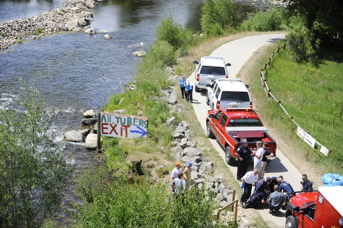 Emergency responders perform CPR on a man Tuesday after he was pulled from the Yampa River. They were not able to revive him. It is suspected the man suffered from a medical problem.