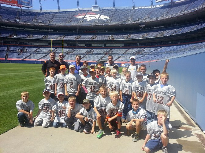 A group of 30 Hayden youth football players went to Denver on Monday to attend the Broncos training camp and tour Sports Authority Field at Mile High.