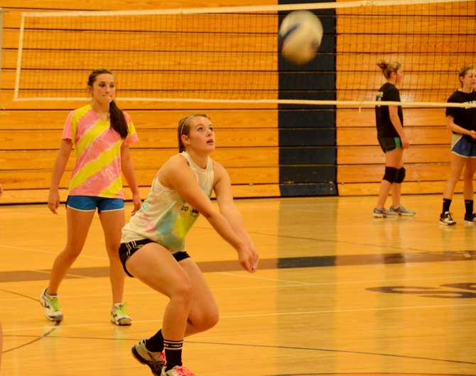 Emily White sets up for a bump during volleyball practice at the Moffat County High School gym. The MCHS volleyball team has seven seniors and a host of returning upperclassmen, giving the Bulldogs high hopes for the upcoming 2013 season.