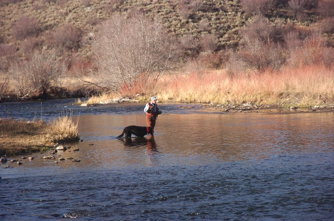 A man fishes near the confluence of Sarvis Creek and the Yampa River. Western Rivers Conservancy, a nonprofit based in Oregon, purchased about 40 acres in the area with the intent to eventually open access to the public.