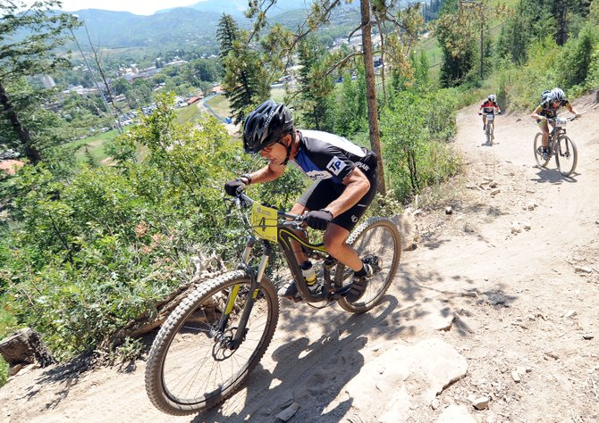 Riders work their way up the Steamboat Stinger course Saturday. The event drew more than 500 riders to compete either on relay teams or solo on the 50-mile course that looped around Emerald Mountain above downtown.