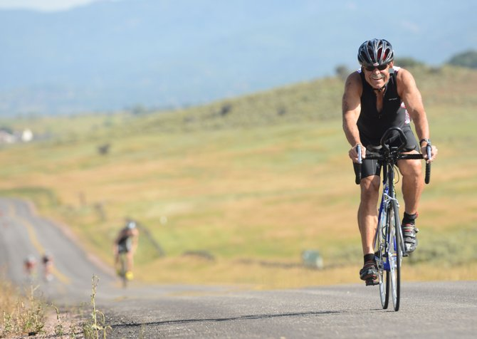 Steamboat Springs triathlete John Holland nears the end of the bike stage of Sunday's ninth annual Steamboat Springs Triathlon at Lake Catamount.