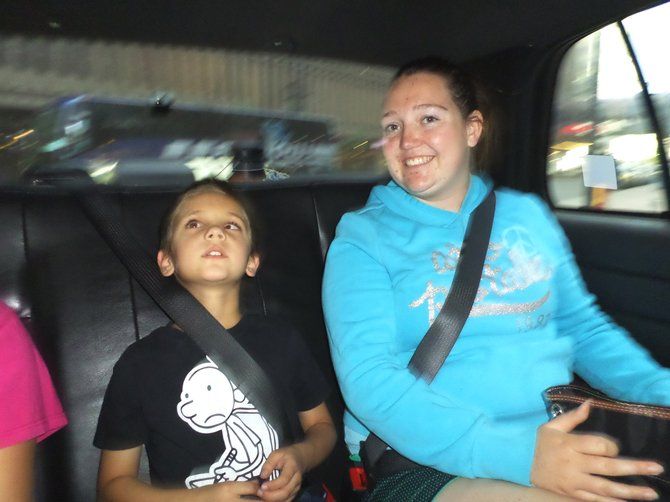 Cousins Brayden Martinez, left, and Isadora Hitz ride in a Denver taxicab in July as part of BELL Camp, a program for blind and visually impaired children. Hitz also recently attended a national convention through the National Federation of the Blind to learn about the issues the blind community faces.