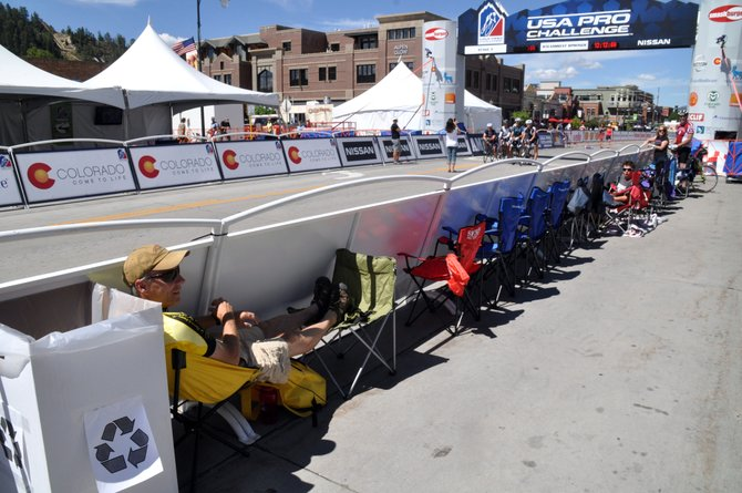Mike Cruse lounges around at noon to safeguard his prime spot to watch the USA Pro Challenge finish in downtown Steamboat Springs. Fans started camping out at the finish line as early as 8:30 a.m. prior to the expected finish time of 4:45 p.m.