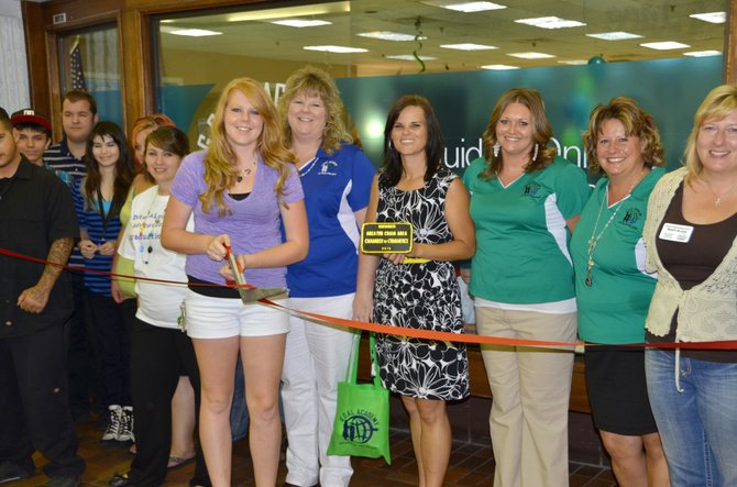 Kyri Scroggs cuts the ceremonial ribbon at the grand opening of GOAL Academy's new drop-in learning center in Centennial Mall. The online charter school offers services to students in need of flexible schedules, different levels of teacher involvement or a separate pace as they pursue their high school degree.
