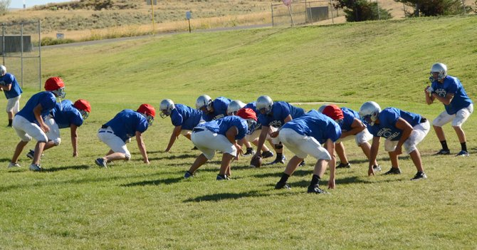 Moffat County football players work on plays during practice this week at the high school. They scrimmage with Coal Ridge in New Castle on Saturday, a week before opening the 2013 season at Ridgeview Academy.