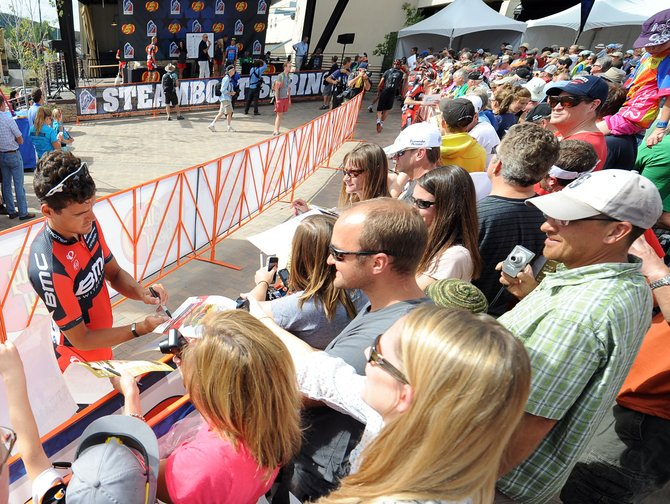 A BMC rider signs autographs at the Stage 4 start Thursday in Steamboat Springs. The USA Pro Challenge left town after rushing into it Wednesday morning.